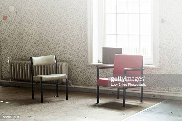 chairs in abandoned asylum - lucy shires stock pictures, royalty-free photos & images