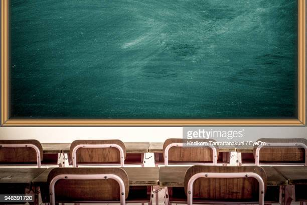 chairs in classroom - blackboard stock photos and pictures