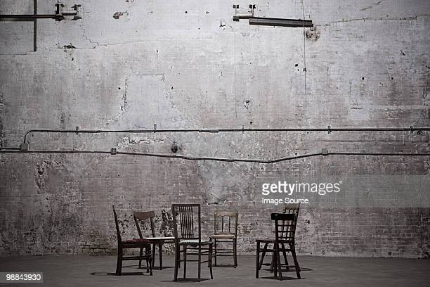 Chairs in empty warehouse