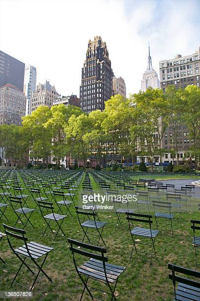 chairs in park arranged in perfect rows. - bryant park stock pictures, royalty-free photos & images