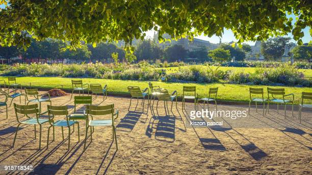 chairs in Tuilleries garden in Paris during summer holidays , France
