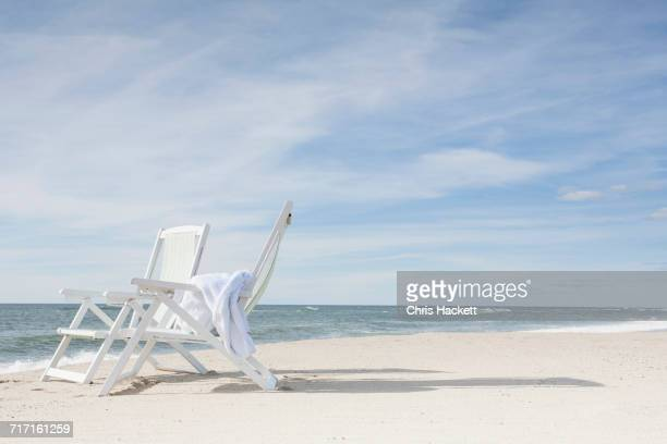 Chairs on beach after sunrise