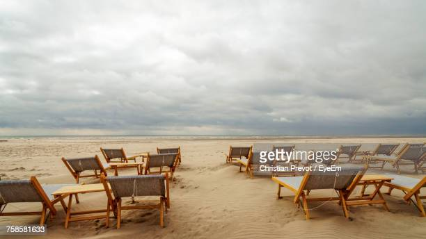 chairs on beach against sky - le touquet paris plage stock pictures, royalty-free photos & images