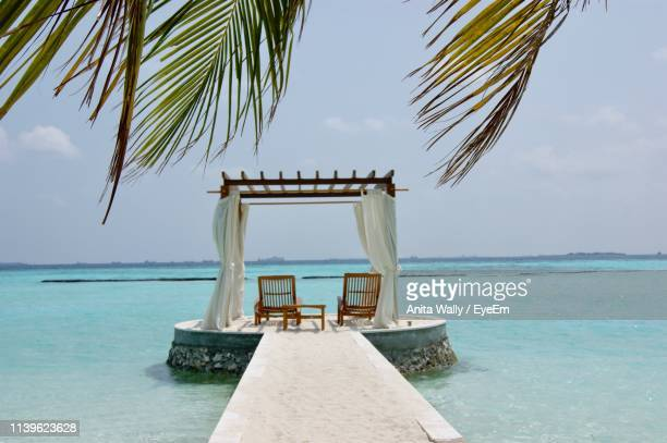 chairs on gazebo at sea against sky - gazebo stock pictures, royalty-free photos & images