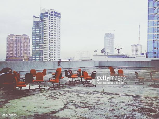 Chairs On Roof With Skyscrapers In Background