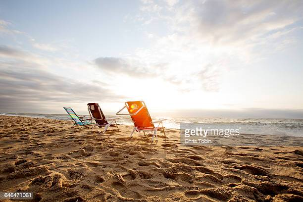 chairs on the beach - outdoor chair stock pictures, royalty-free photos & images