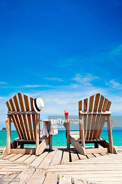 chairs on tropical coast