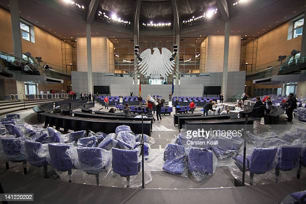 Chairs packed with plastic wrap in the plenary hall of the Bundestag ahead of the upcoming gathering of the Federal Assembly on March 13 2012 in...