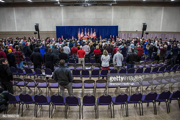 Chairs remain unfilled in the back of the room as Republican presidential candidate Donald Trump speaks at a campaign rally at the Ramada Waterloo...
