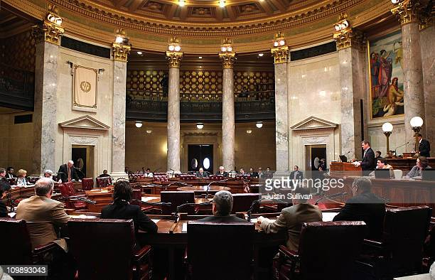 Chairs sit empty during a session of the State Senate at the Wisconsin State Capitol on March 9 2011 in Madison Wisconsin As demonstations continue...