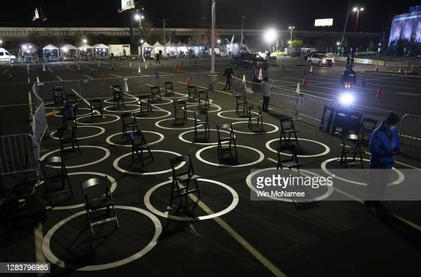 Chairs sit ready for reporters inside circles marked for social distancing as a COVID-19 precaution in the press area at a drive-in election night...