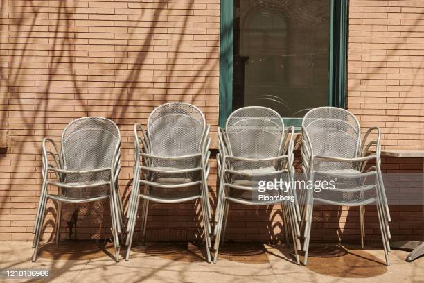 Chairs sit stacked outside a restaurant in Sioux Falls South Dakota US on Wednesday April 15 2020 South Dakota Governor Kristi Noem has argued that...