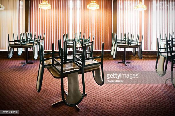 chairs stacked on tables in an empty restaurant - no people stock pictures, royalty-free photos & images