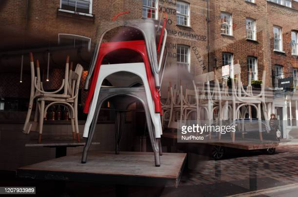 Chairs stand on tables at a closed Italian restaurant on Monmouth Street in the Seven Dials neighbourhood of London England on March 21 2020 Much of...