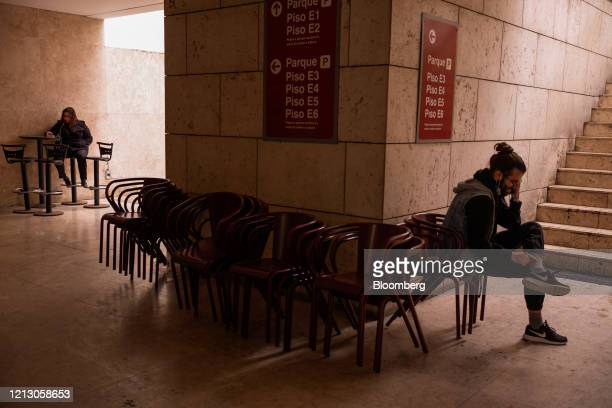 Chairs stand stacked by a closed cafe near to Rua Garret in the Chiado neighborhood in Lisbon, Portugal on Thursday, May 14, 2020. The European...