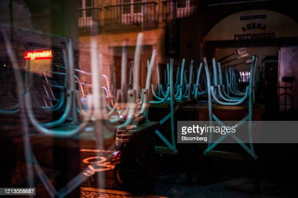 Chairs stand stacked inside a shuttered restaurant on Rua Nova do Carvalho, also known as Pink Street, in Cais Sodre, Lisbon, Portugal on Thursday,...