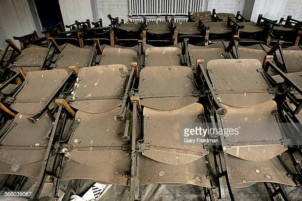 Chairs that were burned remain in the charred auditorium of Garfield High School in East Los Angeles as seen on September 21 2009 The auditorium was...