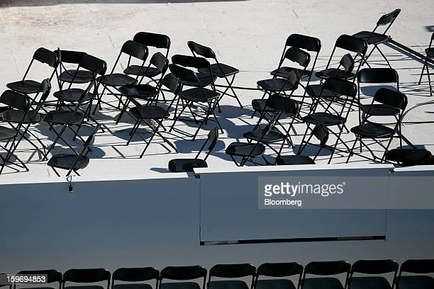 Chairs wait to be positioned outside the US Capitol prior to the second inauguration of US President Barack Obama in Washington DC US on Friday Jan...