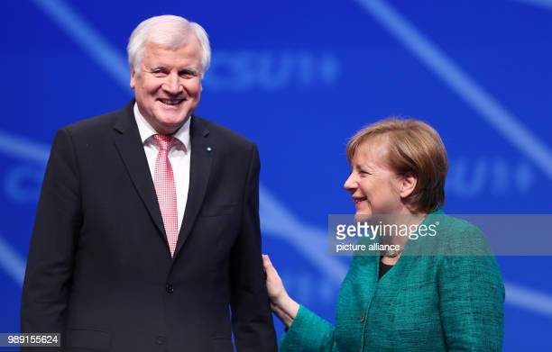 CDUchairwoman and chancellor Angela Merkel standing next to CSUchairman and Bavarian Premier Horst Seehofer after her speach during the CSU's party...