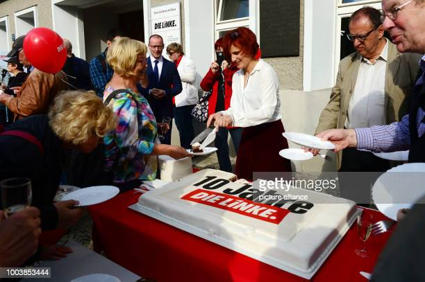 Chairwoman Katja Kipping of the political party 'The Left' passes out pieces from a birthday cake during the reception for the party's 10th...