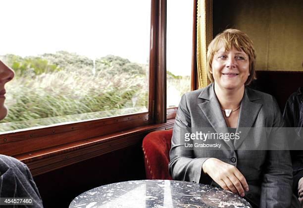Chairwoman of the Christian Democratic Union CDU Angela Merkel riding in the saloon car Kaiserwagen of the Borkum light railway operated by AG Ems on...