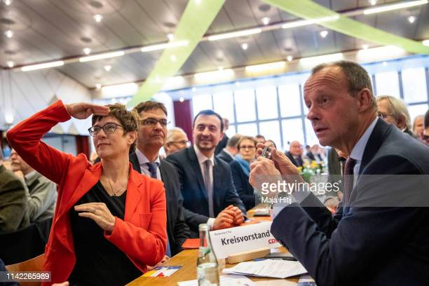 Chairwoman of the German Christian Democrats Annegret KrampKarrenbauer and Friedrich Merz look on during CDU European Elections Campaign launch on...