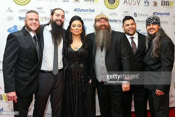 Chairwoman of Vettys Inaugural Ball Assal Ravandi poses with Aaron Austin Norris Ian Dehle Hank Barbe Kevin Martinez and John Eric Delazerda of Three...
