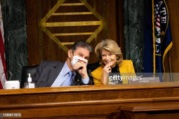 Chairwoman Sen. Lisa Murkowski confers with Sen. Joe Manchin during the confirmation hearing for Secretary of Energy nominee Jennifer Granholm before...