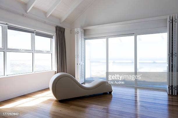 chaise longue in a room - chaise longue stock photos and pictures