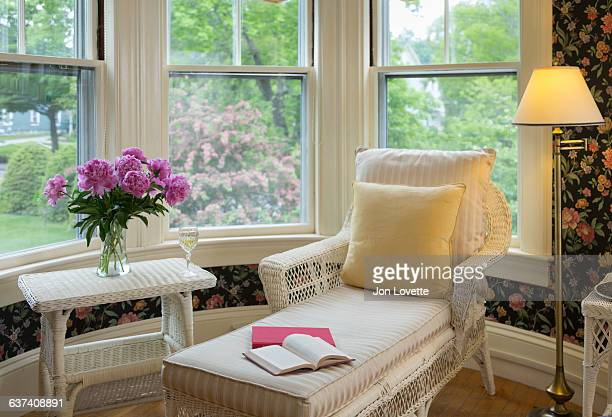 chaise lounge in bedroom - chaise longue stock photos and pictures