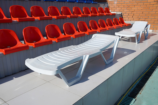 Chaise lounge in the swimming pool 586920044