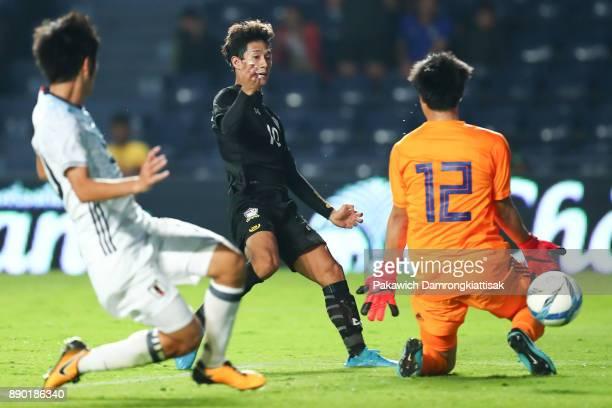 Chaiyawat Buran of Thailand U23 scores the winning goal of the game pass Osako Keisuke of Japan U20 during the M150 Cup 2017 between Thailand U23 and...