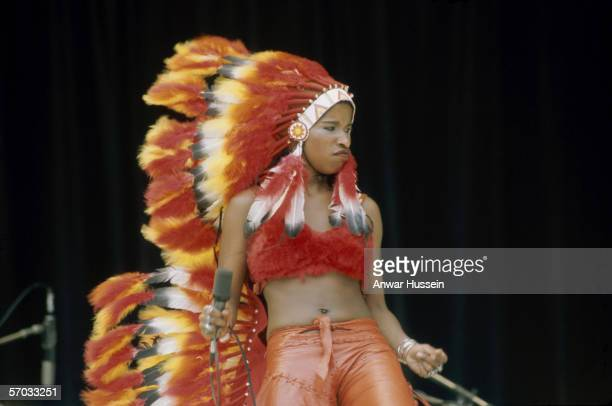 Chaka Khan lead singer of American funk group Rufus performing in a native American costume circa 1975