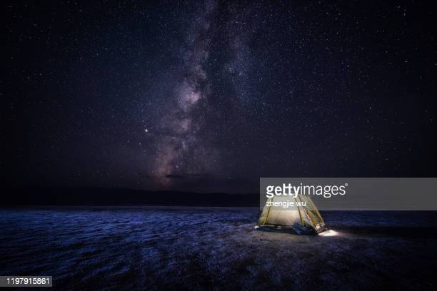 chaka salt lake tent camp above the milky way , china - star shape stock pictures, royalty-free photos & images