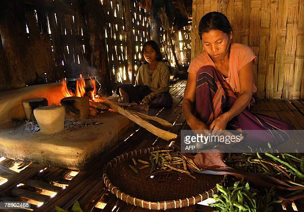 A Chakma mother cooks in her house in the Bijoypur Chakma refugee village in Diyun about 700 kms from Itanagar capital of the northeastern state of...