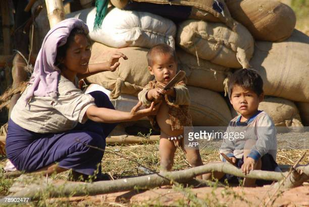 Chakma women mother sits with her children in the Bijoypur Chakma refugee village in Diyun, about 700 kms from Itanagar, capital of the northeastern...