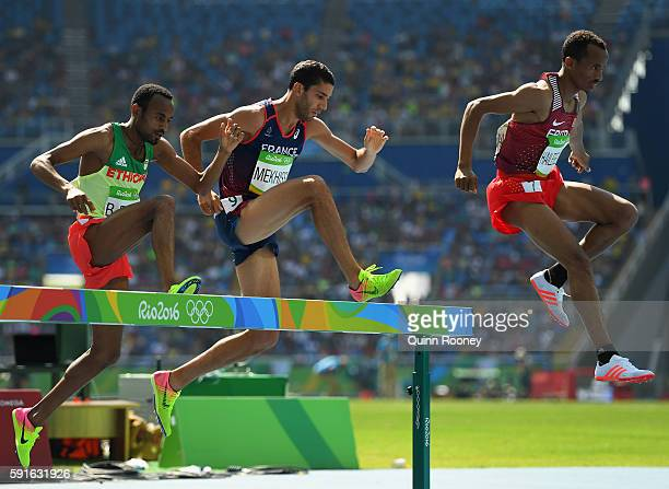 Chala Beyo of Ethiopia Mahiedine Mekhissi of France and Yemane Haileselassie of Eritrea compete during the Men's 3000m Steeplechase Round 1 on Day 10...