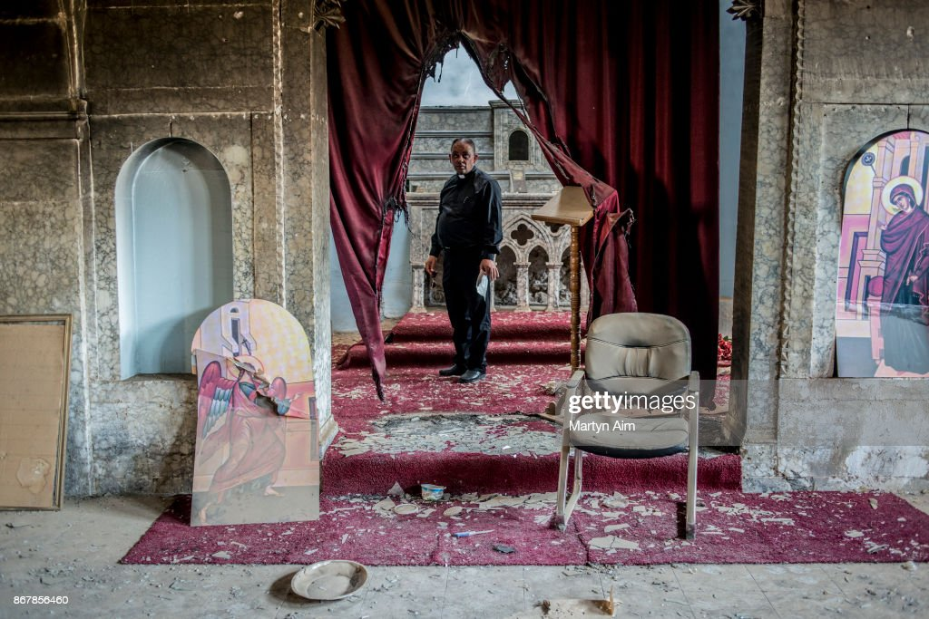 Chaldean Catholic Father Thadet inside a church damaged and burned by Islamic State militants in Karamles, a Christian town in northern Iraq, on September 8, 2017.