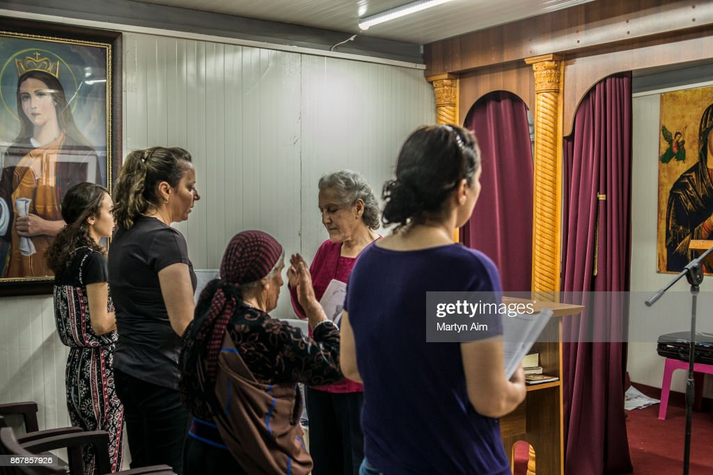 Chaldean Catholic women pray in the chapel in the Karemles Complex in Erbil, northern Iraq, on September 8, 2017. They have been living here for three years since Islamic State militants took the Christian town of Karemles in northern Iraq. They are soon to return to their homes in the town.