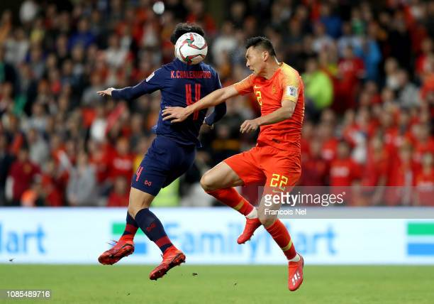 Chalermpong Kerdkaew of Thailand challenges in the air with Yu Dabao of China during the AFC Asian Cup round of 16 match between Thailand and China...