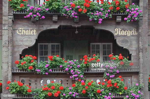 Chalet balcony with flowers.