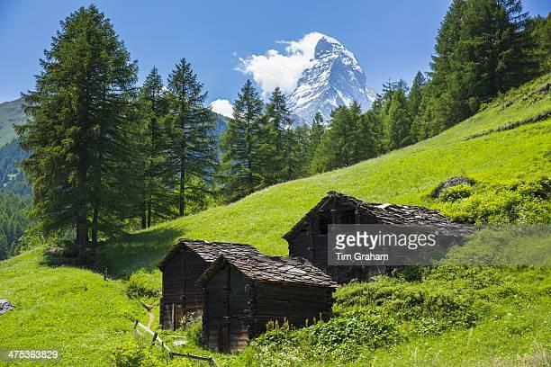 Chalet barns below the Matterhorn mountain in the Swiss Alps near Zermatt Switzerland