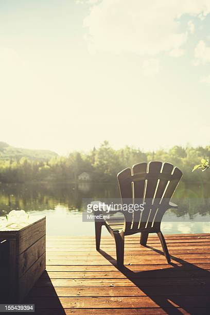 chalet style - sunset lake stock photos and pictures