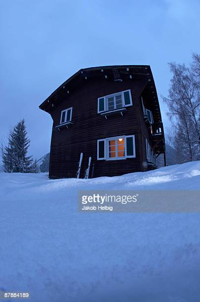 chalet with light inside,  at dusk - courchevel photos et images de collection