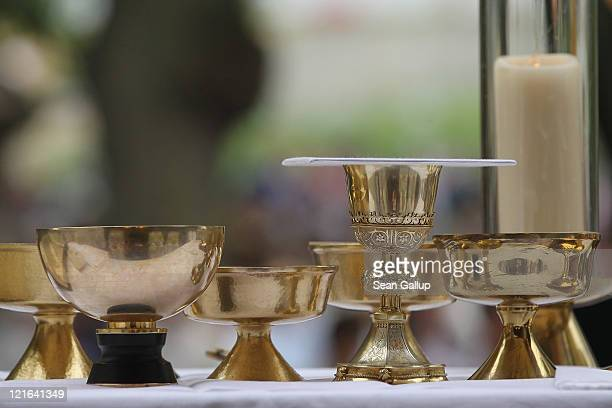 A chalice and communion cups stand on an altar during a Catholic outdoor mass to mark the Ascension of Mary to Heaven at Etzelsbach Chapel on August...