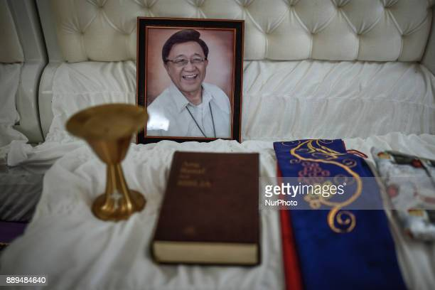 A chalice bible sash and a picture of activist priest Marcelito quotTitoquot Paez who was killed by unidentified assailants is seen on top of his...