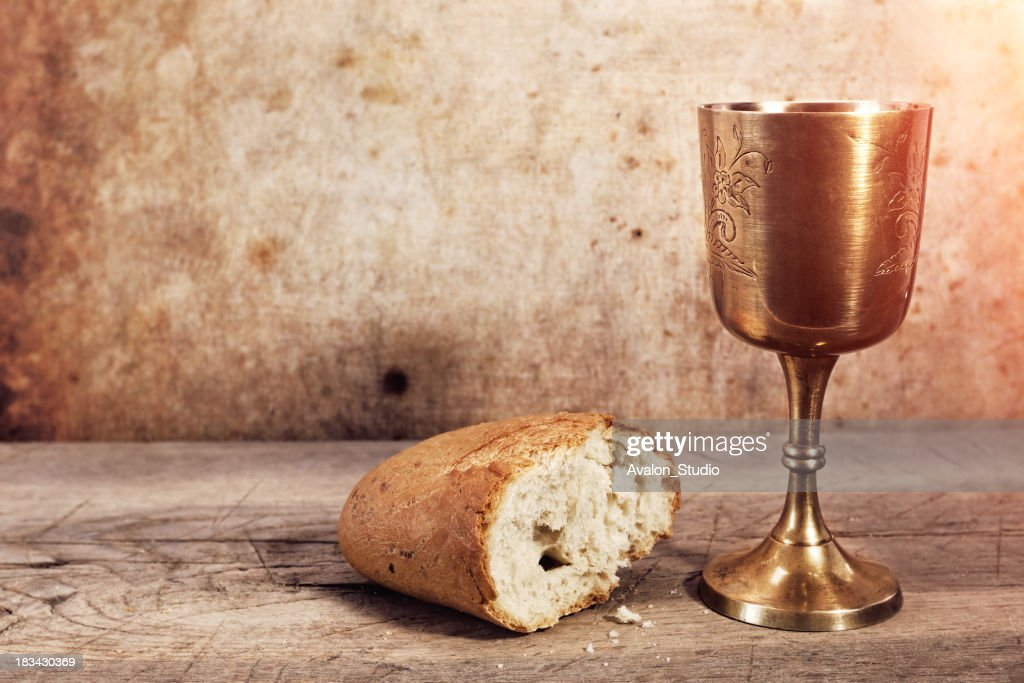 Chalice with wine and bread. : Stock Photo