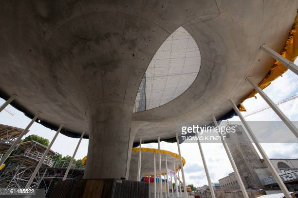 Chalice-shaped supports stand on the construction site of the Stuttgart 21 railway project in front of the old main station tower in Stuttgart,...