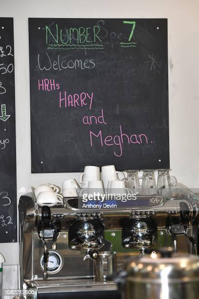 A chalk board announces the royal visit as the Duke and Duchess of Sussex unveil a plaque as they officially open Number 7 a Feeding Birkenhead...