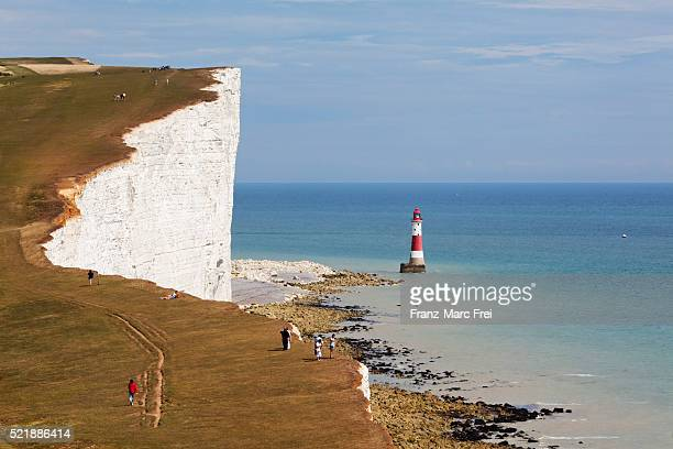 Chalk cliffs of the Sussex Downs and Beachy Head Lighthouse